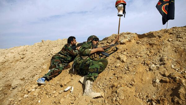 FILE - This Friday, Nov. 22, 2013 file photo, Iraqi and Lebanese Shiite fighters from a group called the Hussein Brigade use a helmet to draw a sniper into view in the town of Hejeira, in the countryside of Damascus, Syria - Sputnik International