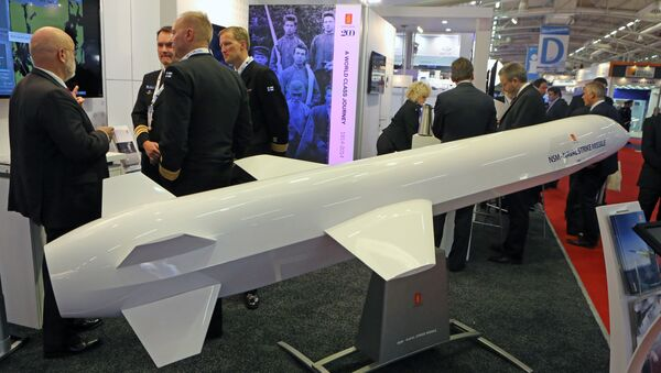 Visitors are gathered next to a display of an anti-ship missile made by Norwegian company Kongsberg (File) - Sputnik International