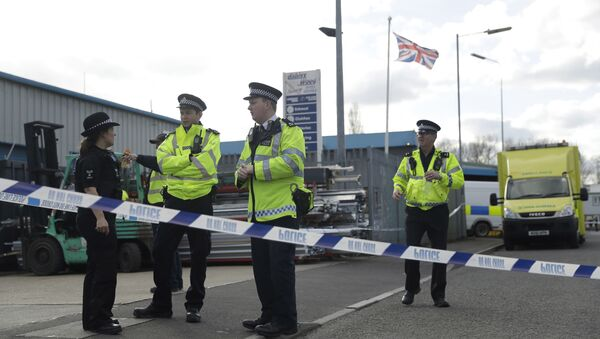 Police officers secure a cordon outside the vehicle recovery business Ashley Wood Recovery in Salisbury, England, Tuesday, March 13, 2018 - Sputnik International