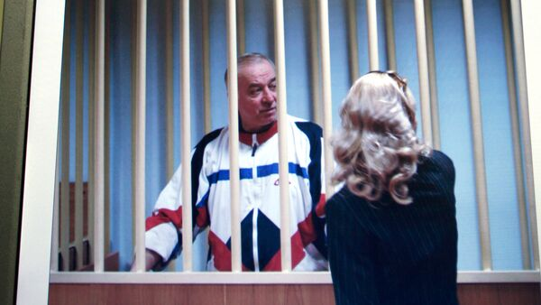 Aug. 9, 2006 file picture Sergei Skripal speaks to his lawyer from behind bars seen on a screen of a monitor outside a courtroom in Moscow - Sputnik International