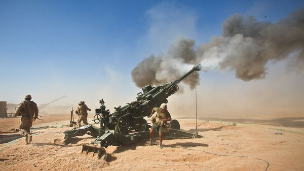 Marines with Charlie Battery, 1st Battalion, 12th Marine Regiment, fire an M982 Excalibur round from an M777 howitzer during a recent fire support mission - Sputnik International