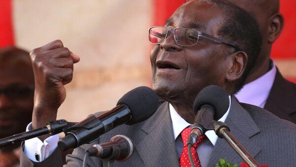 President of Zimbawe Robert Mugabe gestures as he addresses supporters of his ruling ZANU (PF) party (File) - Sputnik International