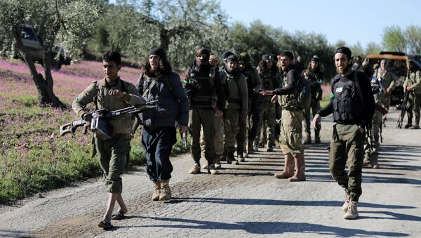 Turkish-backed Free Syrian Army fighters walk together after advancing north of Afrin, Syria March 17, 2018 - Sputnik International