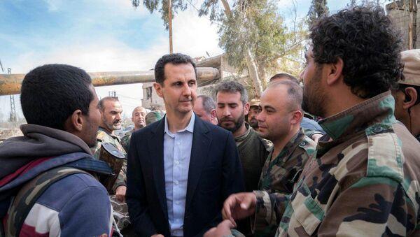 Syrian President Bashar al-Assad meets with Syrian army soldiers in eastern Ghouta, Syria, March 18, 2018 - Sputnik International