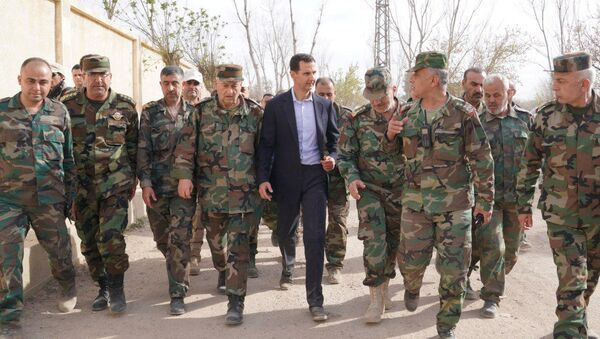 Syrian President Bashar al-Assad walks with Syrian army soldiers in eastern Ghouta, Syria, March 18, 2018 - Sputnik International