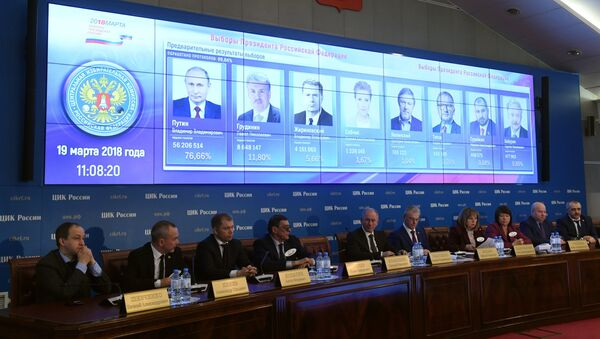 Preliminary results of the Russian presidential election shown on a screen at the information center of the Russian Central Election Commission. Fourth right: Ella Pamfilova, chairperson of the Russian Central Election Commission - Sputnik International