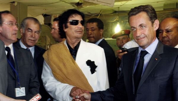 Libya's President Muammar Gaddafi (L) greets his counterpart from France Nicolas Sarkozy at Bab Azizia Palace in Tripoli July 25, 2007, the day after the release of six foreign medics from Libyan jails - Sputnik International