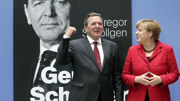 German Chancellor Angela Merkel, right, and former German Chancellor Gerhard Schroeder, left, pose during a photo call prior to the book presentation of Schroeder's biography in Berlin, Germany, Tuesday, Sept. 22, 2015 - Sputnik International