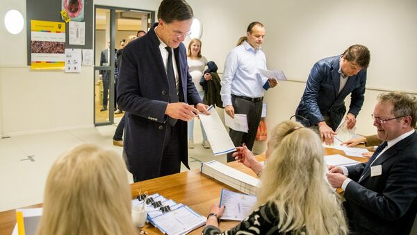 Dutch Prime Minister and The People's Party for Freedom and Democracy (VVD) leader Mark Rutte casts his vote during the Dutch municipal elections at a polling station in The Hague - Sputnik International