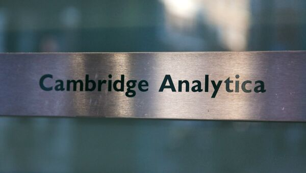 A Cambridge Analytica sign is pictured at the entrance of the building which houses the offices of Cambridge Analytica, in central London - Sputnik International