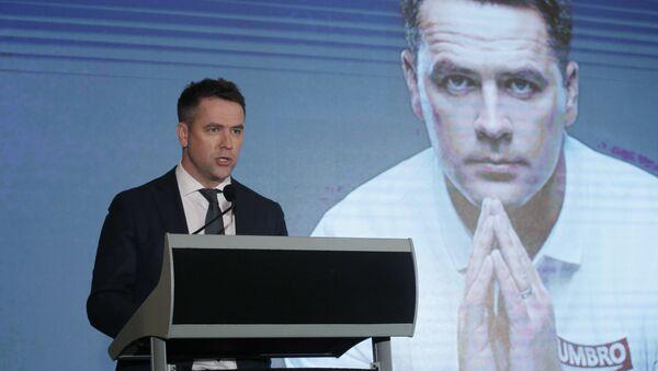 Former British football player Michael Owen speaks during a news conference in Hong Kong. File photo - Sputnik International