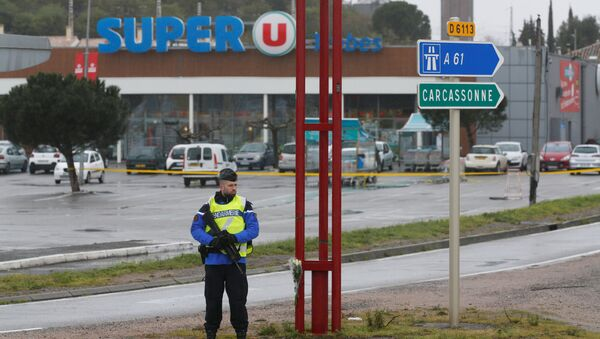 A French gendarme secures the access to a supermarket after a hostage situation in Trebes, France - Sputnik International