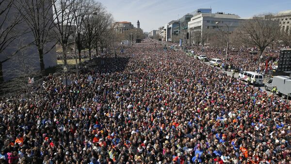 Looking west away from the stage, the crowd fills Pennsylvania Avenue during the March for Our Lives rally in support of gun control, Saturday, March 24, 2018, in Washington. - Sputnik International