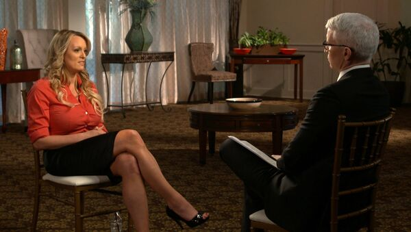This image released by CBS News shows Stormy Daniels, left, during an interview with Anderson Cooper which will air on Sunday, March 25, 2018, on 60 Minutes. - Sputnik International