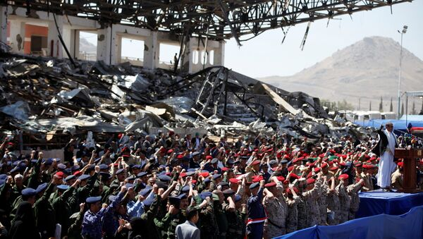 Army officers allied with the Houthis attend a rally at a parade square damaged by air strikes to mark the third anniversary of the Saudi-led intervention in the Yemeni conflict in Sanaa, Yemen March 26, 2018 - Sputnik International