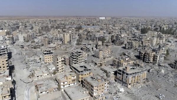 (File) This Thursday, Oct. 19, 2017 frame grab made from drone video shows damaged buildings in Raqqa, Syria - Sputnik International
