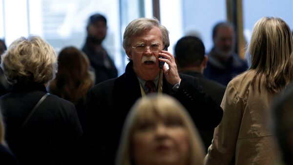 Former U.S. Ambassador to the United Nations John Bolton speaks on a mobile phone as he arrives for a meeting with U.S. President-elect Donald Trump at Trump Tower in New York, U.S., December 2, 2016 - Sputnik International