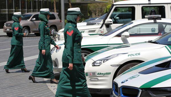 In this Thursday May 19, 2016 photo, Dubai police women walk towards their luxury cars during a demonstration in Dubai, United Arab Emirates - Sputnik International