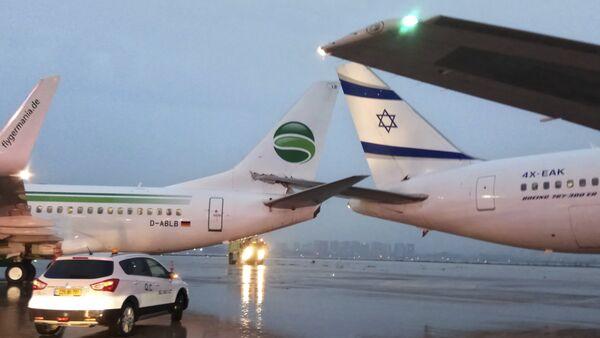 Airplanes are seen at the Ben Gurion airport near Tel Aviv, Israel, Wednesday, March 28, 2018 - Sputnik International