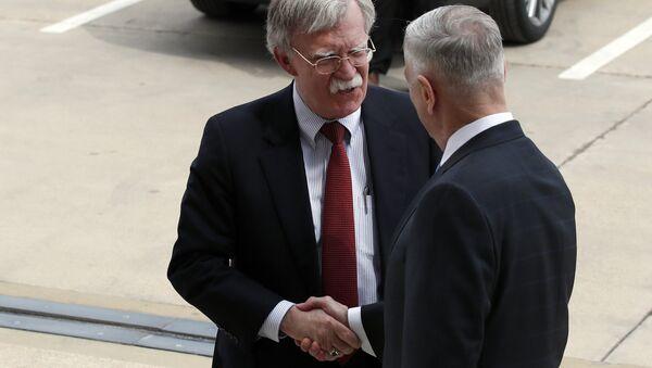 President Donald Trump's pick for national security adviser John Bolton, left, shakes hands with Defense Secretary Jim Mattis, as Bolton arrives at the Pentagon, Thursday, March 29, 2018, in Washington. - Sputnik International