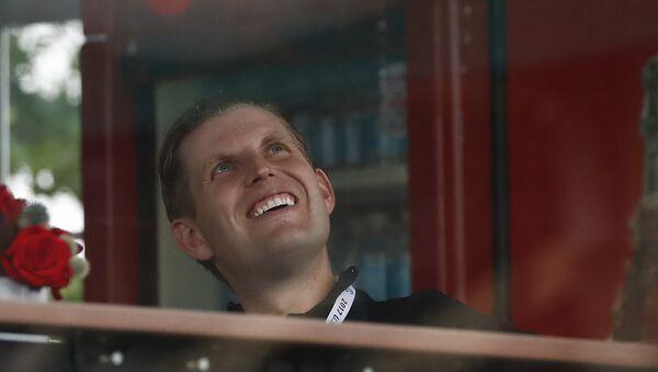 Eric Trump, the son of President Donald Trump, looks out from the presidential viewing stand, Friday, July 14, 2017, at Trump National Golf Club in Bedminster, N.J.  - Sputnik International