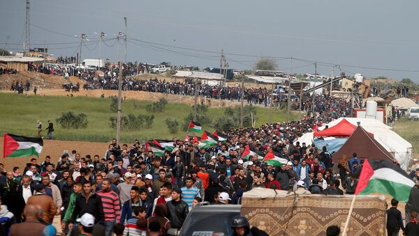 Palestinians attend a tent city protest along the Israel border with Gaza, demanding the right to return to their homeland, east of Gaza City - Sputnik International