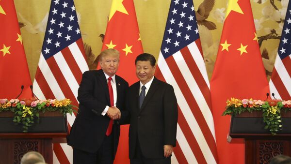U.S. President Donald Trump and Chinese President Xi Jinping shakes hands during a joint press conference at the Great Hall of the People, Thursday, Nov. 9, 2017, in Beijing. (File) - Sputnik International