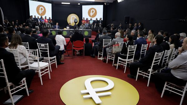 The Venezuelan cryptocurrency Petro logo is seen as Venezuela's President Nicolas Maduro speaks during a meeting with the ministers responsible for the economic sector at Miraflores Palace in Caracas, Venezuela March 22, 2018 - Sputnik International