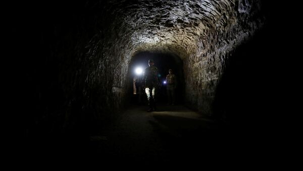 A member of Syrian forces of President Bashar al Assad walks inside a tunnel that was used by rebels in Jobar, eastern Ghouta, in Damascus, Syria April 2, 2018 - Sputnik International