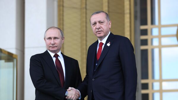 Turkish President Tayyip Erdogan shakes hands with his Russian counterpart Vladimir Putin during a welcoming ceremony at the Presidential Palace in Ankara on April 3, 2018 - Sputnik International