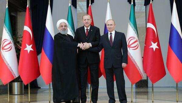 Russian President Vladimir Putin, Turkish President Recep Tayyip Erdogan and Iranian President Hassan Rouhani, right to left, pose for a photo before a meeting in Ankara - Sputnik International