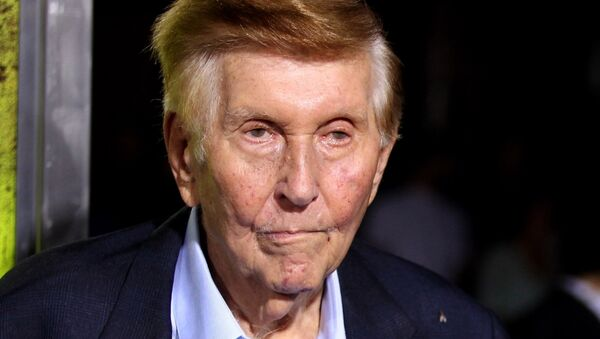 FILE - In this Oct. 1, 2012, file photo, Sumner Redstone attends the premiere of Seven Psychopaths in Los Angeles. On Thursday, Sept. 29, 2016, Redstone's firm, National Amusements, the company that controls CBS and Viacom, announced it wants the two media companies to combine again, more than a decade after they went their separate ways. CBS Corp. produces TV shows and owns its namesake network. Viacom Inc. owns cable channels MTV, Nickelodeon and VH1. - Sputnik International
