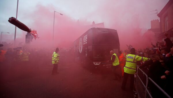 Liverpool fans set off flares and throw missiles at the Manchester City team bus outside the stadium before the match. - Sputnik International