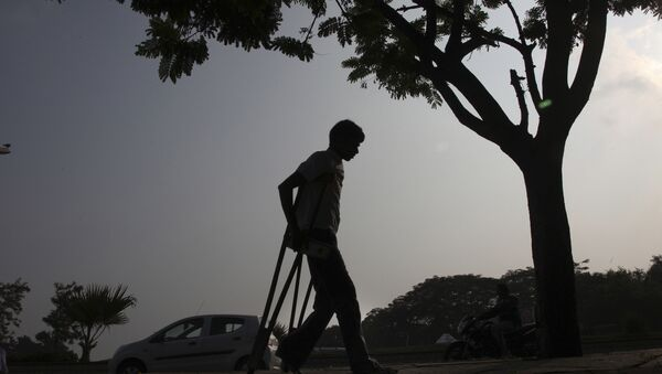 A physically disabled man returns after participating in a walk in Hyderabad, India. (File) - Sputnik International