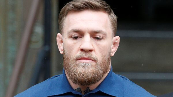 Mixed Martial Arts fighter Conor McGregor is escorted by New York City Police (NYPD) detectives from the 78th police precinct after charges were laid against him in the Brooklyn borough of New York City, U.S., April 6, 2018 - Sputnik International
