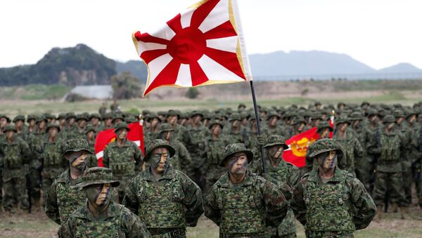 Soldiers of Japanese Ground Self-Defense Force (JGSDF)'s Amphibious Rapid Deployment Brigade, Japan's first marine unit since World War Two, gather at a ceremony activating the brigade at JGSDF's Camp Ainoura in Sasebo, on the southwest island of Kyushu, Japan April 7, 2018 - Sputnik International