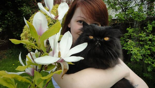 Ms Skripal pictured with one of her father's two cats - one has died and the other is missing - Sputnik International