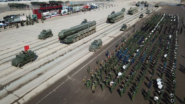 Tigr armored vehicles with Arbalet remote controlled weapon stations and RS-24 Yars transporter-launcher containers during a Victory Day Military Parade rehearsal at the Alabino military training ground in the Moscow Region - Sputnik International