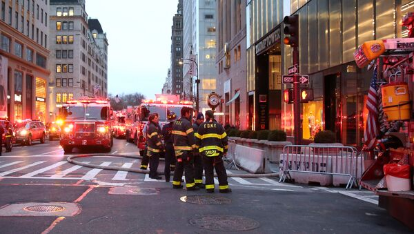 First responders work on a fire in a residential unit at Trump tower in the Manhattan borough of New York City - Sputnik International