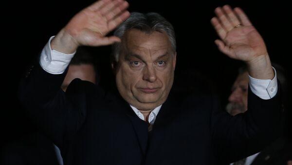 Hungarian Prime Minister Viktor Orban gestures in Budapest, Hungary, Sunday, April 8, 2018 - Sputnik International