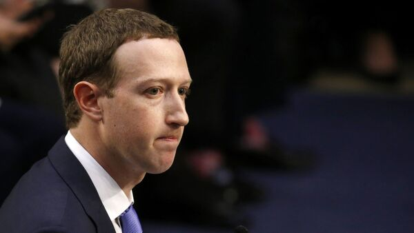 Facebook CEO Mark Zuckerberg listens while testifying before a joint Senate Judiciary and Commerce Committees hearing regarding the company's use and protection of user data, on Capitol Hill in Washington, U.S., April 10, 2018. - Sputnik International