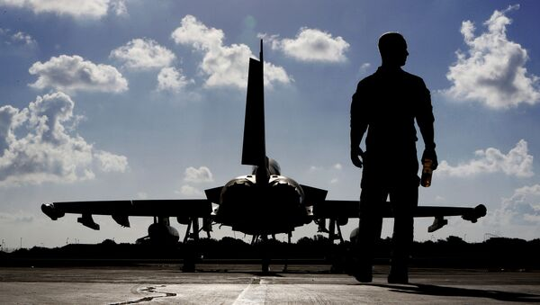 In this Thursday, Sept. 22, 2016 photo, a British soldier walks by a Typhoon aircraft before take off for a mission in Iraq, at RAF Akrotiri, near the southern coastal city of Limassol, in Cyprus - Sputnik International