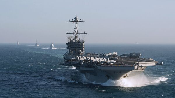 The aircraft carrier group of the United States Navy led by USS Harry S. Truman, front, and a ship escort are seen leaving the port of Norfolk heading for the Middle East - Sputnik International