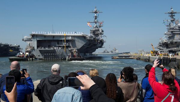 Family members look on as the U.S. Navy aircraft carrier USS Harry S. Truman departs with its carrier strike group towards the Middle East from Naval Station Norfolk, Virginia, U.S. April 11, 2018 - Sputnik International