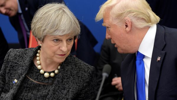 US President Donald Trump, right, speaks to British Prime Minister Theresa May in a working dinner meeting during the NATO summit of heads of state and government at the NATO headquarters, in Brussels on Thursday, May 25, 2017. - Sputnik International