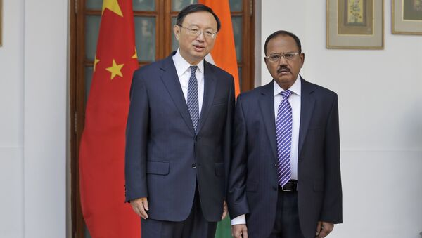 Indian National Security Adviser Ajit Doval, right, poses with Chinese State Councillor Yang Jiechi for photos before their meeting in New Delhi, India. (File) - Sputnik International