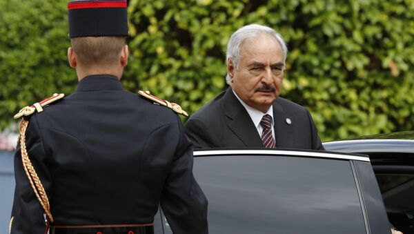 General Khalifa Haftar, commander in the Libyan National Army (LNA), arrives to attend a meeting for talks over a political deal to help end Libya's crisis in La Celle-Saint-Cloud near Paris, France. (File) - Sputnik International