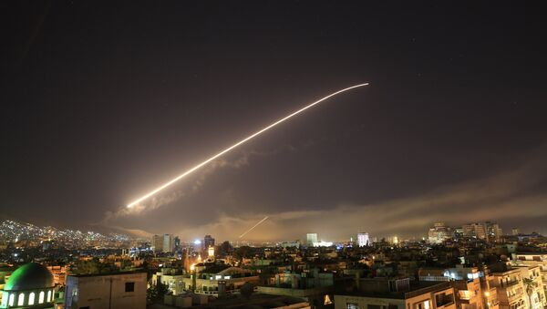 Damascus sky lights up with service to air missile fire as the U.S. launches an attack on Syria targeting different parts of the Syrian capital Damascus, Syria, early Saturday, April 14, 2018. - Sputnik International