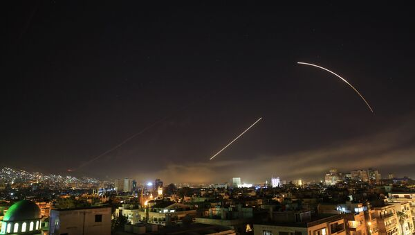 Missiles streak across the Damascus skyline as the U.S. launches an attack on Syria targeting different parts of the capital, early Saturday, April 14, 2018. Syria's capital has been rocked by loud explosions that lit up the sky with heavy smoke as U.S. President Donald Trump announced airstrikes in retaliation for the country's alleged use of chemical weapons. - Sputnik International