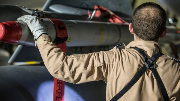 In this image released by Britain's Ministry of Defense, a Tornado pilot checks the weapons on his Tornado at Britain Royal Air Force base in Akrotiri, Cyprus, after its mission to conduct strikes in support of operations over the Middle East Saturday, April 14, 2018 - Sputnik International